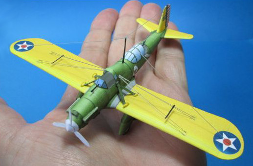 tiny paper a-8 shrike model on a hand