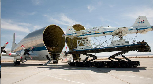 Two T-38s being swallowed by a Super Guppy