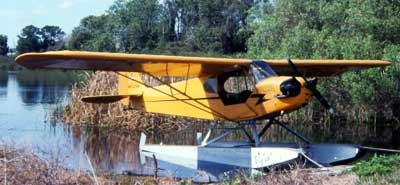Piper J-3 Cub on floats parked