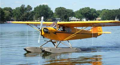 Piper J-3 on floats taxiing