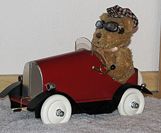 Wolfie's Pedal Car and Teddie
