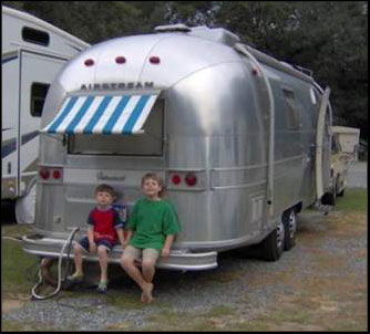 Airstream sitting under the awning
